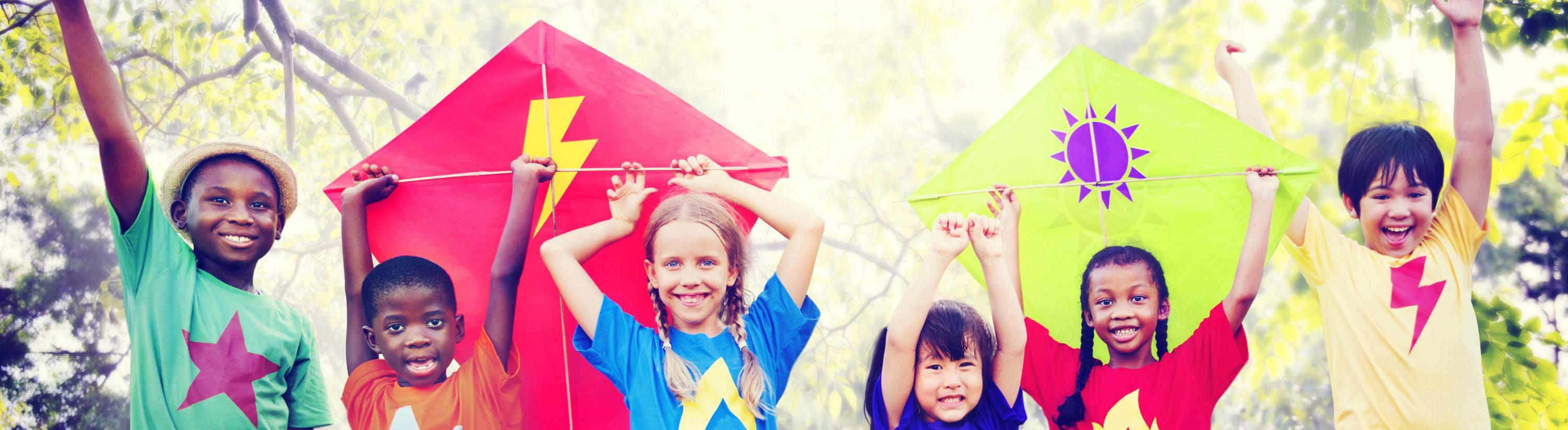 Banner image of children holding their hands up